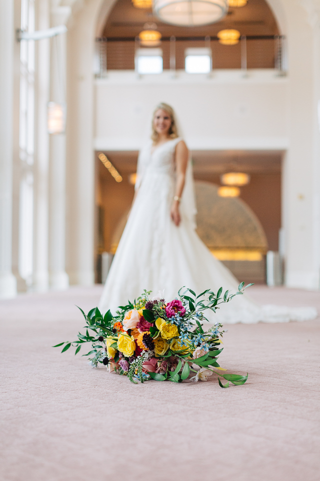 Bride standing behind her wedding bouquet at Bass Performance Hall.
